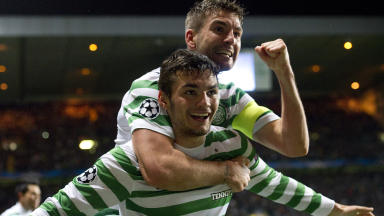 Goal hero: Tony Watt (centre) celebrates his goal against Barcelona with Charlie Mulgrew.