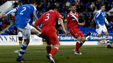 Dave Mackay (left) slots his effort home to break the deadlock for St Johnstone