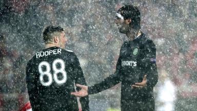 The rain falls in Lisbon as Celtic's Georgios Samaras (right) looks for answers.