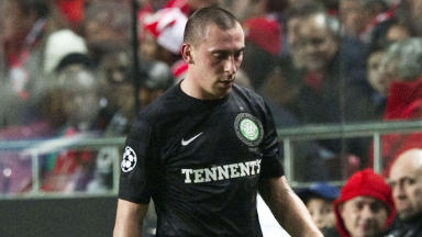 Dejection for Scott Brown as injury forces the Celtic captain off during the second half.