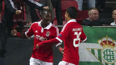Benfica's Ola John (left) celebrates his opening goal with team mates.