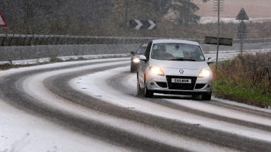 Car in snow during winter in Aberdeenshire  traffic in weatherquality image