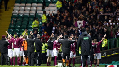 Arbroath players and staff celebrate in front of their jubilant support