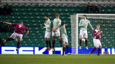 Steven Doris (9) sends his free-kick goal bound courtesy of a deflection from the Celtic wall