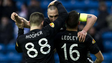 Celtic captain Scott Brown (centre) celebrates his goal with team mates Gary Hooper and Joe Ledley (right).