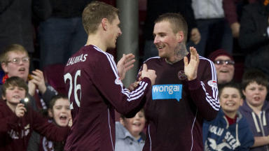 Ryan Stevenson (right) celebrates his penalty with Hearts captain Marius Zaliukas after giving the home side