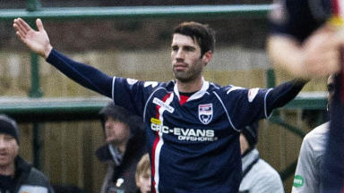 Ross County's Rocco Quinn celebrates opening the scoring.