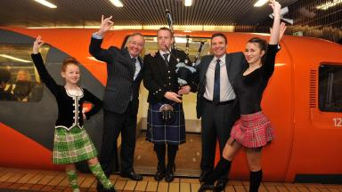 Hogmanay celebrations: Councillor Gordon Matheson, Councillor George Redmond with piper Iain Melvin and dancers Collette Black and Sarah Stirling from the Maryanne McCreadie School of Highland Dance.