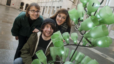 Recycle: Two RGU design students create a Christmas tree from used bottles.