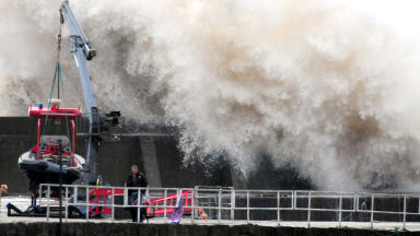 Stonehaven flooding, waves crashing over the harbour. Quality image.