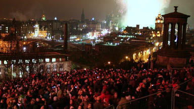 Street party: Thousands of people descend on Edinburgh for Hogmanay.