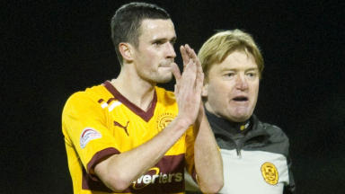 Motherwell's Jamie Murphy (left) salutes the home support at full time