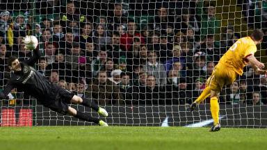 Celtic goalkeeper Fraser Forster saves a penalty from Tom Hateley.