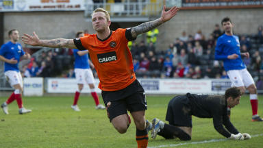 Dundee Utd's Johnny Russell charges off to celebrate his second goal of the game