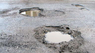 Driving danger: Water in the paving creates cracks in the road, leading to potholes.