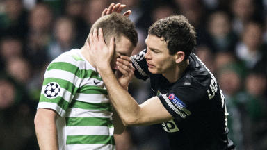 Juventus' Stephan Lichtsteiner (right) consoles James Forrest at full-time