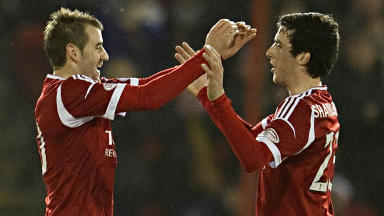 Niall McGinn (left) celebrates his goal with Aberdeen team-mate Joe Shaughnessy.
