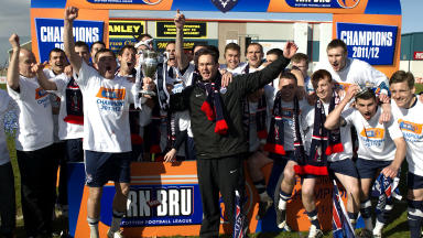 Ross County celebrate winning the 2011/12 Scottish First Division.