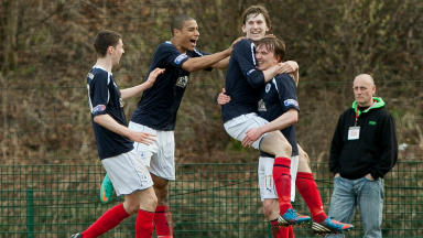 Falkirk players celebrate their win.
