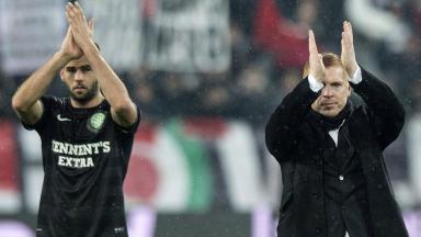 Celtic's Joe Ledley (left) joins manager Neil Lennon in applauding the travelling fans