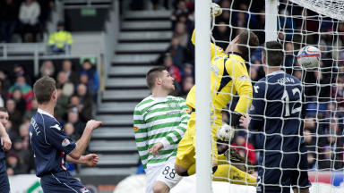 Ross County keeper Michael Fraser (centre) fails to keep out Charlie Mulgrew's corner as the Celtic defender scores.