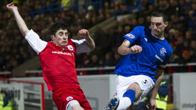 Stirling Albion's Danny Ashe (left) blocks off Lee Wallace's cross.