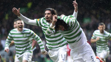 Celtic star Georgios Samaras wheels away to celebrate after scoring the winning goal with an overhead kick