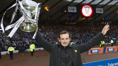 St Mirren manager Danny Lennon with the trophy
