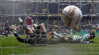 Scott Vernon (left) slots the ball past Celtic keeper Fraser Forster to bring Aberdeen back on level terms at 1-1