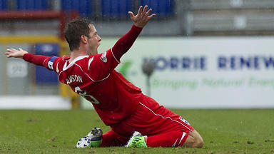 Ross County captain Paul Lawson celebrates in style after bagging the equaliser.