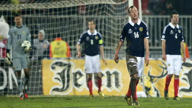 Scotland players despondent after conceding the opening goal of the game
