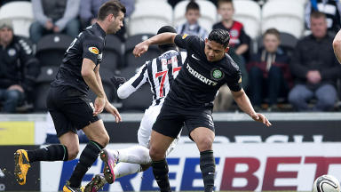 St Mirren's Esmael Goncalves wins his side a penalty as he's taken down by Emilio Izaguirre (right)