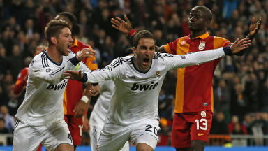 Real Madrid's Gonzalo Higuain (2nd R) celebrates his goal with captain Sergio Ramos passing by Galatasaray Dany Nounkeu during the Champions League quarter-final, first leg soccer match at Santiago Bernabeu stadium in Madrid