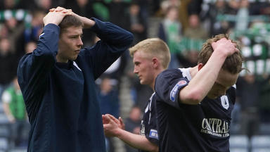 The defeat is too much for Falkirk's Conor McGrandles (left) after the final whistle