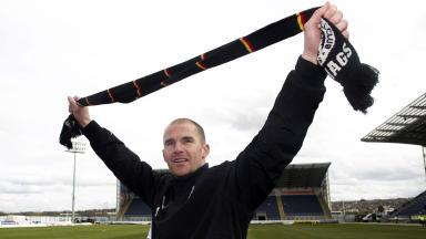 Alan Archibald celebrates Partick Thistle's First Division title win.