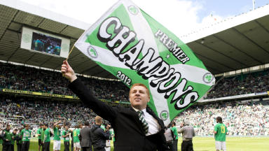 Neil Lennon celebrates Celtic's second consecutive league title.