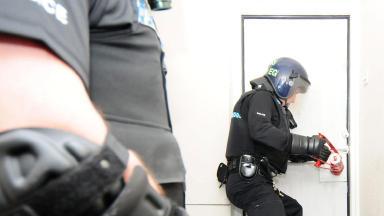 Police raid door smash drugs dawn raid operation quality image