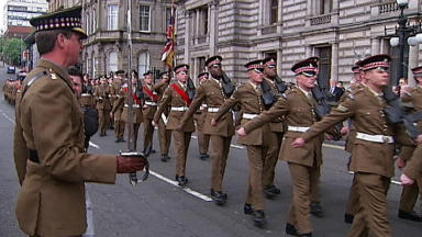 Well-wishers lined the streets of Glasgow on Saturday to give the Scots Guards at heroes' welcome home from Afghanistan.  Around 250 soldiers marched through the city centre to celebrate their return from a six-month tour of duty in Helmand Province, where they were deployed to the Upper Gereshk Valley.  The troops were sent to Afghanistan as part of Operation Herrick 17 between October 2012 and April 2013.