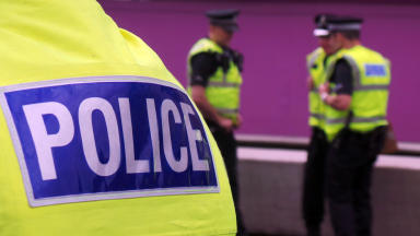 Generic police photo with prominent police logo in foreground and officers in background. Police generic photo. Police officer, policeman, Police Scotland #policegeneric