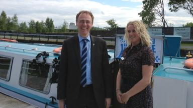 All aboard: Dr Alasdair Allan and Dr Debbie McNeill the director of the Glasgow Science Festival.