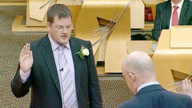 SNP MSP Mark McDonald is sworn in after Aberdeen Donside byelection victory. June 25 2013. STV screengrab.