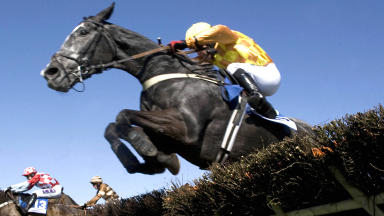 Generic shot of jockey on horse jumping a hurdle at Ayr Race Course