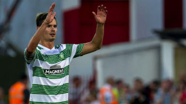 Celtic's Mikael Lustig celebrates at full time.