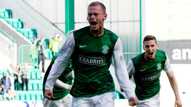 Scott Robertson races off to celebrate after grabbing an equalising goal for Hibernian