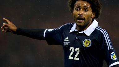 Ikechi Anya makes his debut for Scotland.
