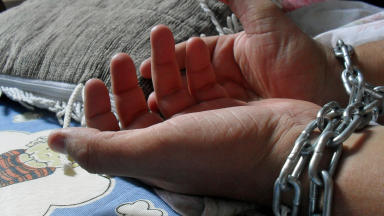 Generic CC licensed hands in chains human trafficking