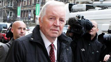 Ex-Dunfermline MSP Bill Walker turns up for domestic abuse sentencing at Edinburgh Sheriff Court.