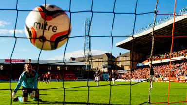 Dundee Utd ace Andrew Robertson (left) leaves Motherwell keeper Lee Hollis on his knees after striking the ball into the back of the net.