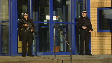 Armed police at Helen Street police station in Govan, October 23 2013