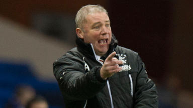 Rangers manager Ally McCoist issues instructions to his players.